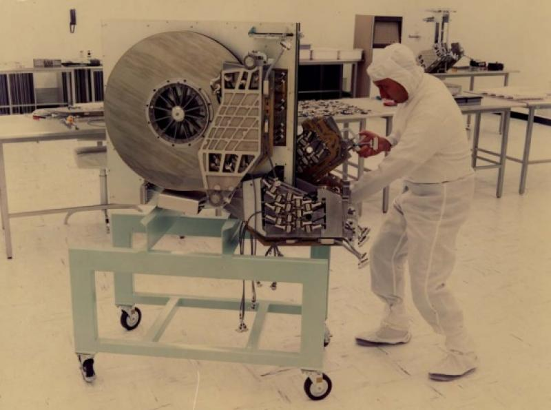 A 250MB hard disk drive in production. Found at http://royal.pingdom.com/2010/02/18/amazing-facts-and-figures-about-the-evolution-of-hard-disk-drives/